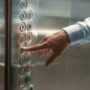 Employee touching elevator buttons in the workplace